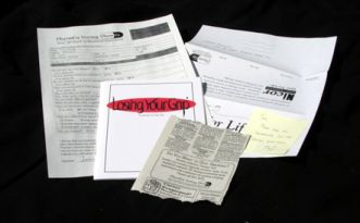 Feelies for 'Losing Your Grip' (manual, newspaper clipping, medical form and advertisement proof with corrections)