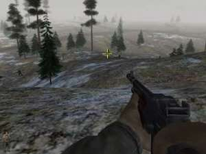 First person perspective from Battlefield 1942 showing a man aiming a gun through a snow-filled forest at an enemy soldier