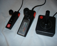 From left to right, pack-in controllers: Atari Flashback, Atari 7800 and Atari 2600