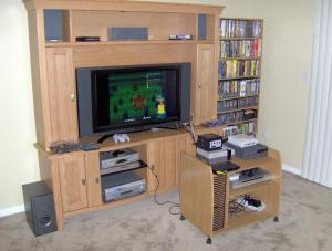 The entertainment center. Note the rolling cart for game consoles.